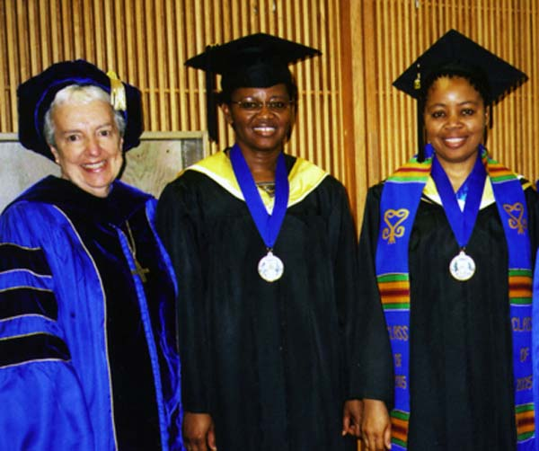 Sister Mary Laxague with two Sister graduates