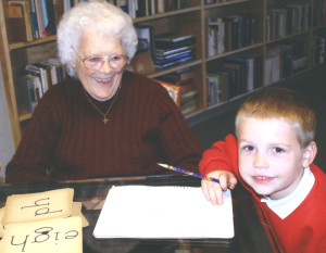 Sister Alberta tutors a student