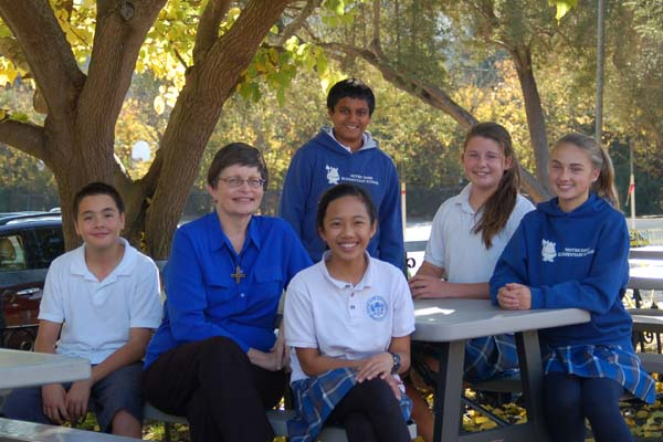 Notre Dame Elementary School (Belmont) Principal Sr. Kathryn Keenan and students.
