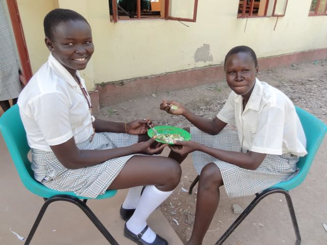 "Girls sharing food, part of the ""modern miracle"" of Loreto school"